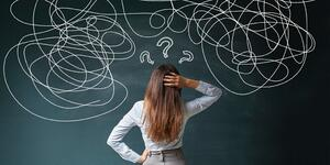 businesswoman-mess-on-blackboard-picture-id637689814 (1)